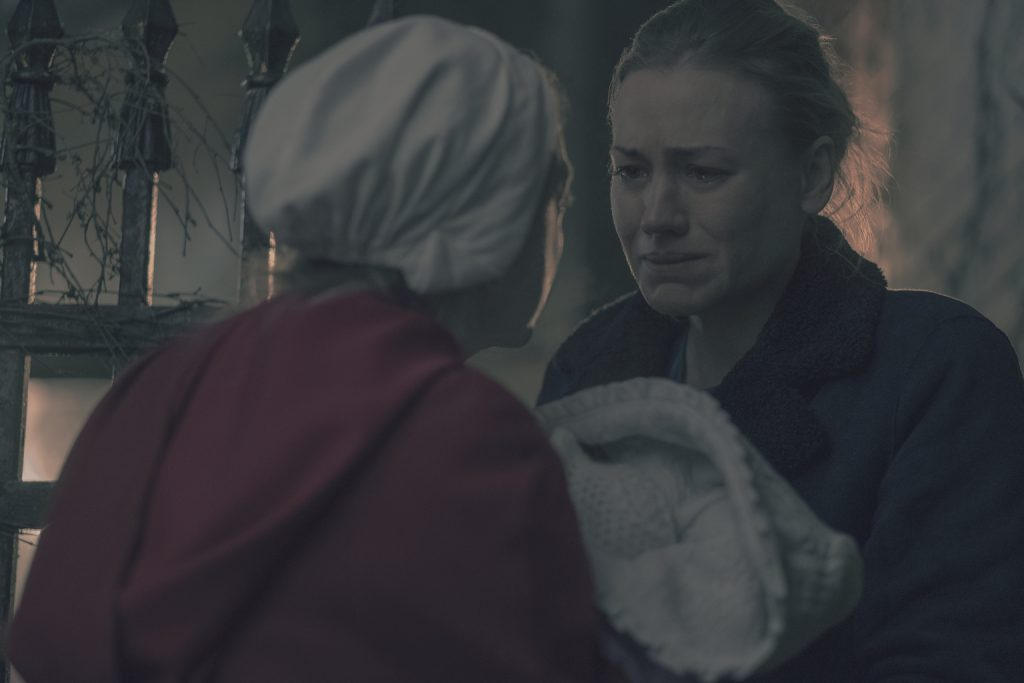the relationship between commander and offred in handmaids