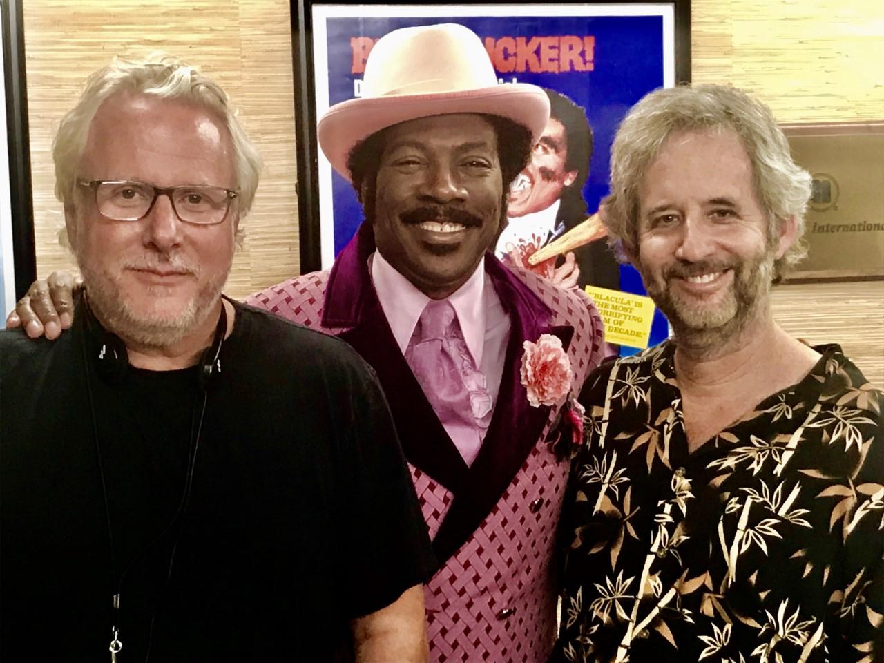 Larry Karaszewski, Eddie Murphy, and Scott Alexander on the set of Dolemite Is My Name.